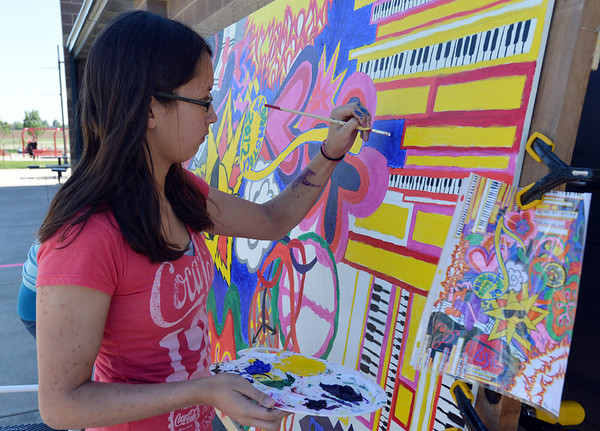 Mali Glaister, 15, paints the mural for Broomstock 2012 at the Broomfield County Commons on Thursday.<br /> <br /> May 24, 2012 <br /> staff photo/ David R. Jennings