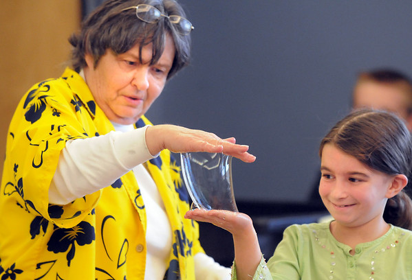 Bubble master Nancy Winkler, left, exchanges a bubble with Rachel Halperin, 8, during the Fun in a Bubble program exploring the world of bubbles at Mamie Doud Eisenhower Public Library. <br /> December 29, 2010<br /> staff photo/David R. Jennings