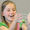Ava Barjenbruch, 7, plays with a bubble with her hands during the Fun in a Bubble program exploring the world of bubbles at Mamie Doud Eisenhower Public Library on Wednesday. <br /> December 29, 2010<br /> staff photo/David R. Jennings