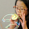 Alisha Heater, 10, makes a bubble using a funnel during the Fun in a Bubble program exploring the world of bubbles at Mamie Doud Eisenhower Public Library on Wednesday. <br /> December 29, 2010<br /> staff photo/David R. Jennings