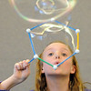 Ashlyn Elggren, 10, blows a large bubble during the Fun in a Bubble program exploring the world of bubbles at Mamie Doud Eisenhower Public Library on Wednesday. <br /> December 29, 2010<br /> staff photo/David R. Jennings