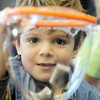 Gryphin Kramer, 6, looks through a bubble he made during the Fun in a Bubble program exploring the world of bubbles at Mamie Doud Eisenhower Public Library on Wednesday. <br /> December 29, 2010<br /> staff photo/David R. Jennings
