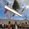 "TOPPING03<br /> Attendees watch the final beam, adorned with flags and an evergreen tree, being lifted into place during a ""topping-off ceremony"" at the University of Colorado's Center for Community building on Monday. <br /> <br /> Photo by Marty Caivano/Camera/Dec. 14, 2009"