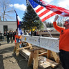 "Construction site employee Laramie Durant straightens out the American flag placed on the final beam during a ""topping-off ceremony at the University of Colorado's Center for Community building on Monday. <br /> <br /> Photo by Marty Caivano/Camera/Dec. 14, 2009"