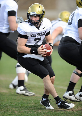 CUFOOTBALL<br /> Quarterback Cody Hawkins runs plays during practice on Friday.<br /> Photo by Marty Caivano/Camera/April 2, 2010