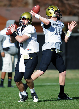 CUFOOTBALL<br /> Quarterbacks Tyler Hansen, left, and Seth Lobato work on drills during practice on Friday.<br /> Photo by Marty Caivano/Camera/April 2, 2010