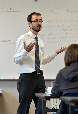 University of Colorado Law School student Garrett Anderson, center,  talks with Legacy High School students about the Fourth Amendment argument during class in recognition of Constitution Day at the school on Friday.<br /> September 20, 2012<br /> staff photo/ David R. Jennings