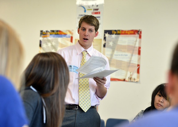 University of Colorado Law School student Drew Kraniak, center, works with Legacy High School students on a Fourth Amendment argument during class in recognition of Constitution Day at the school on Friday.<br /> September 20, 2012<br /> staff photo/ David R. Jennings