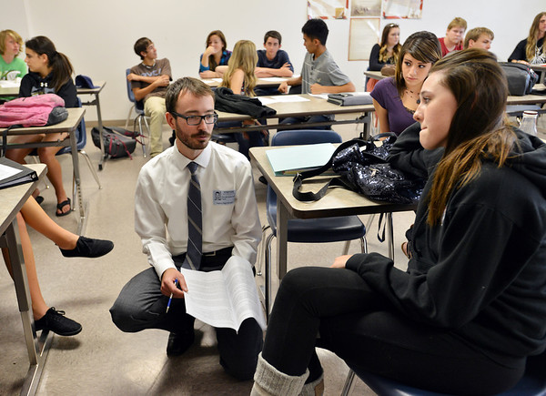 University of Colorado Law School student Garrett Anderson, center,  talks with Legacy High School junior Jenna Frederick, right, about a Fourth Amendment argument for a hypothetical case during class in recognition of Constitution Day at the school on Friday.<br /> September 20, 2012<br /> staff photo/ David R. Jennings