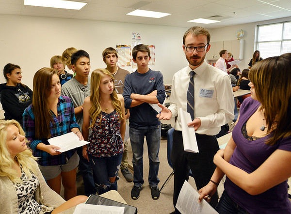 University of Colorado Law School student Garrett Anderson, second right,  talks with Legacy High School students about a Fourth Amendment argument for a hypothetical case during class in recognition of Constitution Day at the school on Friday.<br /> September 20, 2012<br /> staff photo/ David R. Jennings