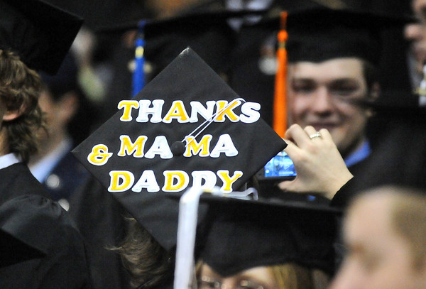 GRAD09<br /> A graduate sends a thank-you message on her mortarboard during the University of Colorado's winter commencement on Friday.<br /> <br /> Photo by Marty Caivano/Camera/Dec. 18, 2009