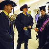 GRAD02<br /> John Graves, second from left, shows off the belt buckle he wore to the University of Colorado's winter commencement on Friday. With him are, left to right, Steve Green, Cooper Naitove, and Sean Franklin. Graves and Green were Ralphie handlers for the CU football team.<br /> <br /> Photo by Marty Caivano/Camera/Dec. 18, 2009