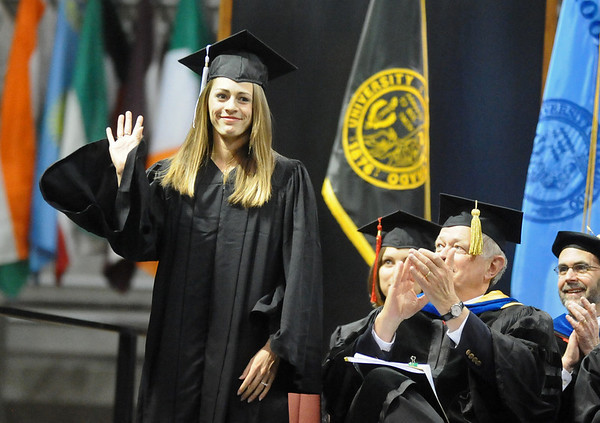 GRAD11<br /> Jenny Barringer, accomplished student-athlete in cross-country and track and field, waves to the audience during the University of Colorado's winter commencement on Friday.<br /> <br /> Photo by Marty Caivano/Camera/Dec. 18, 2009