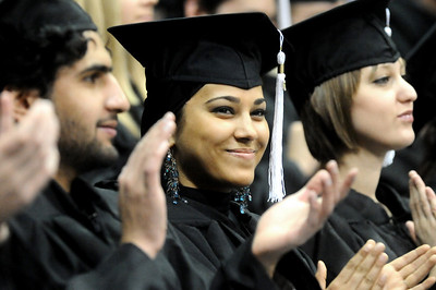 GRAD17 Miriam Motaweh, who received a bachelor's degree in sociology, applauds after the undergraduates were conferred their degrees during the University of Colorado's winter commencement on Friday.  Photo by Marty Caivano/Camera/Dec. 18, 2009