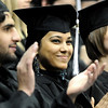 GRAD17<br /> Miriam Motaweh, who received a bachelor's degree in sociology, applauds after the undergraduates were conferred their degrees during the University of Colorado's winter commencement on Friday.<br /> <br /> Photo by Marty Caivano/Camera/Dec. 18, 2009