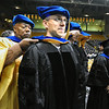 GRAD14<br /> Alexander Zolot, right, is hooded by marshall and assistant vice chancellor Alphonse Keasley during the University of Colorado's winter commencement on Friday. Zolot received a Ph.D in chemical physics.<br /> <br /> Photo by Marty Caivano/Camera/Dec. 18, 2009