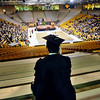 GRAD03<br /> A graduate watches the Coors Event Center fill up with friends and family before the University of Colorado's winter commencement on Friday.<br /> <br /> Photo by Marty Caivano/Camera/Dec. 18, 2009