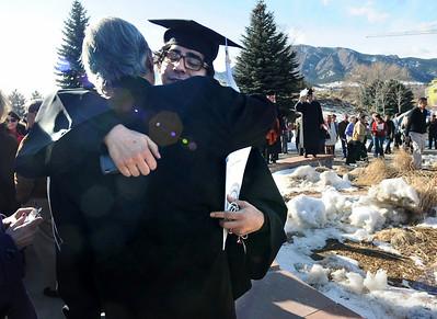 GRAD21 Nicholas Miranda hugs his father, Ramiro, after the University of Colorado's winter commencement on Friday.  Photo by Marty Caivano/Camera/Dec. 18, 2009
