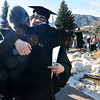 GRAD21<br /> Nicholas Miranda hugs his father, Ramiro, after the University of Colorado's winter commencement on Friday.<br /> <br /> Photo by Marty Caivano/Camera/Dec. 18, 2009