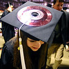 GRAD04<br /> After spending three years as a DJ for CU's Radio 1190, Sarah Parsi wears a 45 rpm record on her mortarboard during the University of Colorado's winter commencement on Friday.<br /> <br /> Photo by Marty Caivano/Camera/Dec. 18, 2009