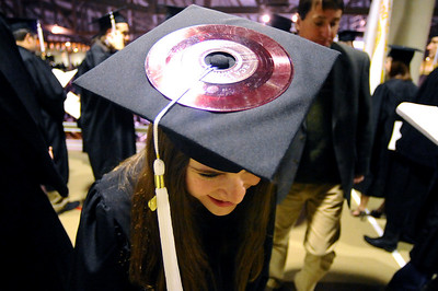 GRAD04 After spending three years as a DJ for CU's Radio 1190, Sarah Parsi wears a 45 rpm record on her mortarboard during the University of Colorado's winter commencement on Friday.  Photo by Marty Caivano/Camera/Dec. 18, 2009