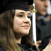 GRAD18<br /> Sarah Parisi, who received a bachelor's degree in linguistics, listens to Norlin's Charge, a speech made by former president George Norlin, which was read during the University of Colorado's winter commencement on Friday.<br /> <br /> Photo by Marty Caivano/Camera/Dec. 18, 2009