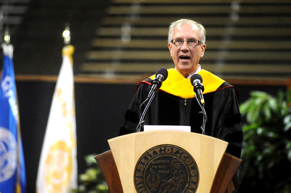GRAD12<br /> Tom Cech, professor and Nobel laureate, delivers the commencement address during the University of Colorado's graduation ceremony on Friday.<br /> <br /> Photo by Marty Caivano/Camera/Dec. 18, 2009
