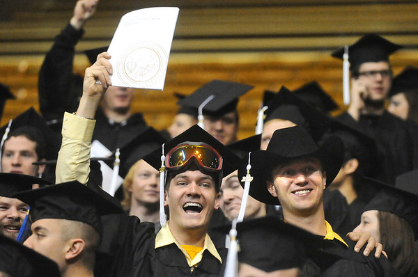 GRAD08<br /> Michael Waring, left, and Cole Schindler celebrate their graduation during the University of Colorado's winter commencement on Friday.<br /> <br /> Photo by Marty Caivano/Camera/Dec. 18, 2009