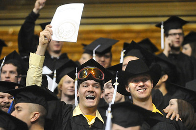 GRAD08 Michael Waring, left, and Cole Schindler celebrate their graduation during the University of Colorado's winter commencement on Friday.  Photo by Marty Caivano/Camera/Dec. 18, 2009