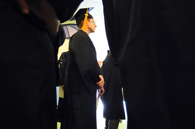 GRAD05 John French, who earned a degree in computer science, stands in line for the processional during the University of Colorado's winter commencement on Friday.  Photo by Marty Caivano/Camera/Dec. 18, 2009