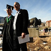 GRAD20<br /> Jesse Lee Goossens, left, poses for a picture with his father, Greg, after the University of Colorado's winter commencement on Friday.<br /> <br /> Photo by Marty Caivano/Camera/Dec. 18, 2009