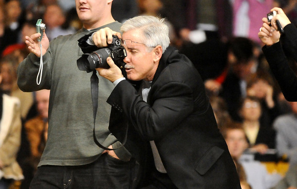 GRAD07<br /> Mike Hulley works to get a good photograph of his daughter, Jillian, during the University of Colorado's winter commencement on Friday.<br /> <br /> Photo by Marty Caivano/Camera/Dec. 18, 2009
