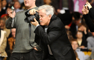 GRAD07 Mike Hulley works to get a good photograph of his daughter, Jillian, during the University of Colorado's winter commencement on Friday.  Photo by Marty Caivano/Camera/Dec. 18, 2009