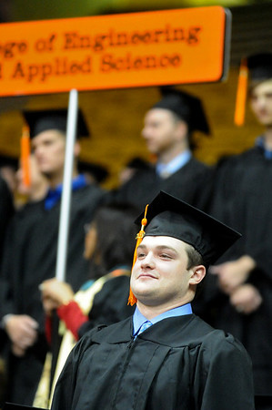 GRAD16<br /> Johnny Archibald stands with the rest of the School of Engineering and Applied Science while they were conferred their bachelor's degrees during the University of Colorado's winter commencement on Friday.<br /> <br /> Photo by Marty Caivano/Camera/Dec. 18, 2009