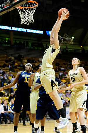 CUCALIF<br /> CU's Meagan Malcolm-Peck snags a rebound against California.<br /> Photo by Marty Caivano/March 21, 2011