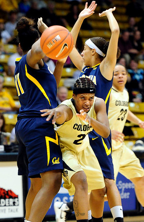 CUCALIF<br /> CU's Brittany Spears fires off a pass to escape pressure from DeNesha Stallworth, left, and Rama N'Diaye of California.<br /> Photo by Marty Caivano/March 21, 2011