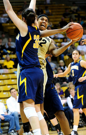 CUCALIF<br /> CU's Brittany Spears gets a shot past Lindsay Sherbert of California.<br /> Photo by Marty Caivano/March 21, 2011