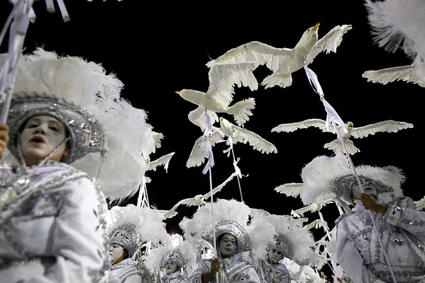 Brazil Carnival.JPEG-09f36.JPG Performers from the Unidos da Tijuca samba school parade during carnival celebrations at the Sambadrome in Rio de Janeiro, Brazil, Tuesday, Feb.21, 2012. Nearly 100,000 paying spectators turn out for the all-night spectacle at the Sambadrome. (AP Photo/Felipe Dana)