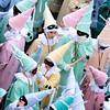Belgium Carnival.JPEG-0d067.JPG Children dressed as harlequins participate at the carnival in the city centre of Binche, Belgium, Tuesday, Feb. 21, 2012, as 'Gilles of Binche' walk and dance during the carnival parade.  The Carnival of Binche dates back to around the 14th Century, with the clown-like Gilles performing their traditional dances to the sound of drums to ward off evil spirits with their sticks. (AP Photo/Yves Logghe)