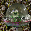 Brazil Carnival.JPEG-01548.JPG A performer sits inside a capsule held to a float during Mangueira samba school carnival parade at the Sambadrome in Rio de Janeiro, Brazil, Tuesday, Feb. 21, 2012.  Nearly 100,000 paying spectators turn out for the all-night spectacle at the Sambadrome.  (AP Photo/Victor R. Caivano)