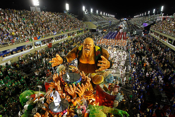 Brazil Carnival.JPEG-0a11e.JPG Dancers of Grande Rio samba school parade on a float during carnival celebrations at the Sambadrome in Rio de Janeiro, Brazil, Tuesday, Feb. 21, 2012.  Nearly 100,000 paying spectators turn out for the all-night spectacle at the Sambadrome. (AP Photo/Victor R. Caivano)