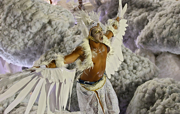 Brazil Carnival.JPEG-0a1a8.JPG A dancer of Grande Rio samba school parades on a float during carnival celebrations at the Sambadrome in Rio de Janeiro, Brazil, Tuesday, Feb. 21, 2012. Nearly 100,000 paying spectators turn out for the all-night spectacle at the Sambadrome. (AP Photo/Victor R. Caivano)