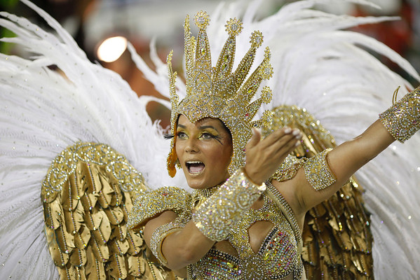 Brazil Carnival.JPEG-0f9c0.JPG A performer from the Grande Rio samba school parades during carnival celebrations at the Sambadrome in Rio de Janeiro, Brazil, Tuesday, Feb.21, 2012.  Nearly 100,000 paying spectators turn out for the all-night spectacle at the Sambadrome. (AP Photo/Felipe Dana)