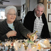 Carol and Marty Clever look at the new addition of a zoo in their Christmas Village containing 53 buildings and over 2000 accessories on a 14 foot long and four foot wide table at their home on Saturday.<br /> December 17, 2011<br /> Staff photo/ David R. Jennings
