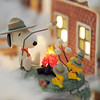 Carol Clever's favorite character, Snoopy, is on display in her Christmas village containing 53 buildings and over 2000 accessories on a 14 foot long and four foot wide table at their home on Saturday.<br /> December 17, 2011<br /> Staff photo/ David R. Jennings
