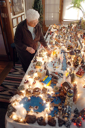 "Carol Clever looks over her and husband Marty's Christmas village containing 53 buildings and over 2000 accessories on a 14 foot long and four foot wide table at their home on Saturday.<br /> For more photos please visit  <a href=""http://www.broomfieldenterprise.com"">http://www.broomfieldenterprise.com</a><br /> December 17, 2011<br /> Staff photo/ David R. Jennings"
