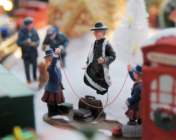 A jump roping priest which is part of Carol and Marty Clever's Christmas village containing 53 buildings and over 2000 accessories on a 14 foot long and four foot wide table at their home on Saturday.<br /> December 17, 2011<br /> Staff photo/ David R. Jennings