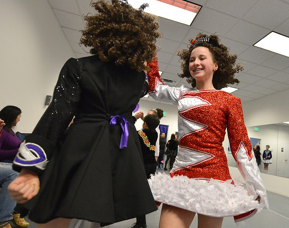 April Levin, 12, right, and Lauren Eckhardt, 12, perform an Irish dance at the Celtic Steps  dance studio on Thursday in Superior.<br /> January 4, 2013<br /> staff photo/ David R. Jennings