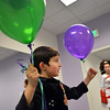 Adam Musaev, 7, gathers balloons at the Celtic Steps  dance studio on Thursday in Superior.<br /> January 4, 2013<br /> staff photo/ David R. Jennings