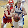 Broomfield's Callie Kaiser reaches for the ball as  Centaurus' Anna Hubbell tries to knock it away during Tuesday's game at Broomfield.<br /> February 19, 2013<br /> staff photo/ David R. Jennings
